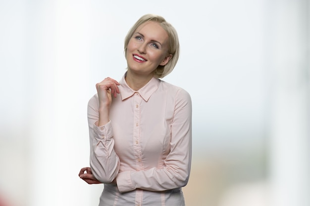 Thoughtful business lady is dreaming about something