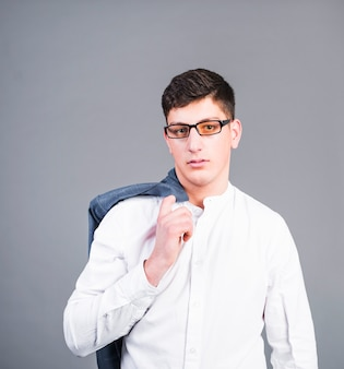 Thoughtful business man holding jacket on shoulder