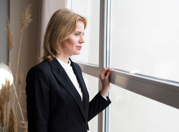 Thoughtful business woman looking at window