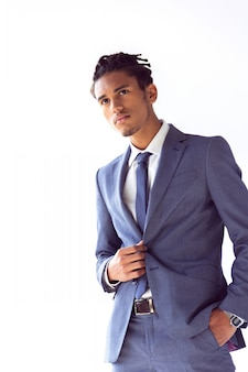 Thoughtful businessman in a blue suit with a hand in his pocket