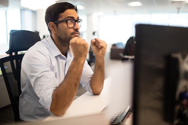 Thoughtful businessman sitting at desk