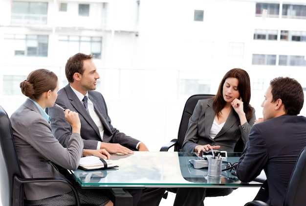 Thoughtful businesswoman talking to her team during a meeting