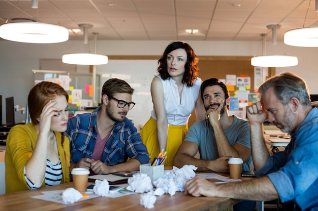 Thoughtful creative business team having a meeting in office