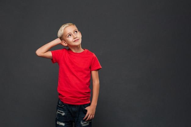 Thoughtful cute little boy child