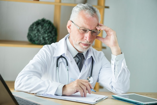 Thoughtful doctor making notes
