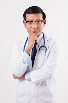 Thoughtful doctor thinking, planning studio isolated