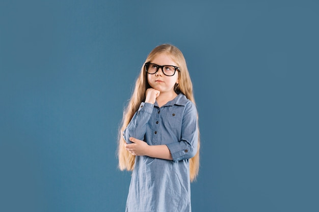 Thoughtful girl in glasses