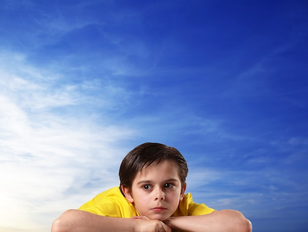 Thoughtful kids in sky background