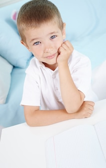 Thoughtful pupil with white t-shirt