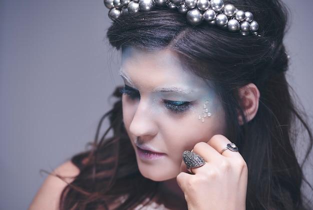 Thoughtful and sad ice maiden at studio shot