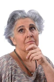 Thoughtful senior woman on white