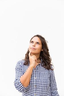 Thoughtful student girl touching chin