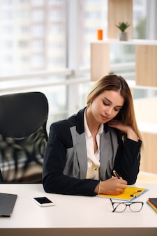 Thoughtful worried business woman looking away, thinking, solving a problem at work