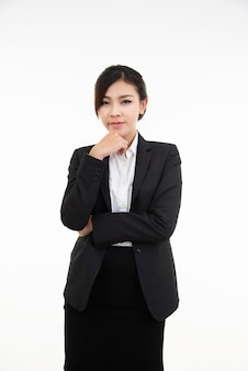 Thoughtful young asian businesswoman resting her chin on her hand and looking straight into the camera