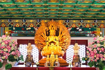 Thousand hands of god image make of wood carving in chinese temple ,Thailand.