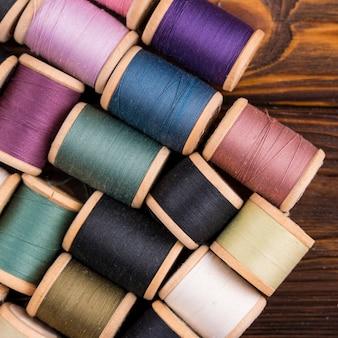Thread spools on wood table