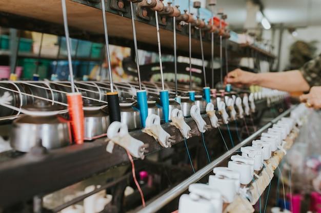 Thread weaving machine - use for weaving traditional thai silk.