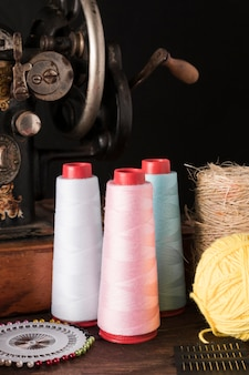 Threads and needles near sewing machine