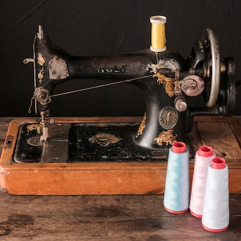 Threads near antique sewing machine
