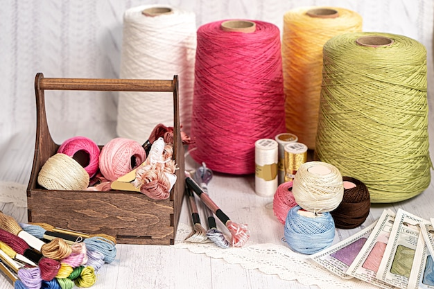 Threads in reels. colored bobbins for embroidery knitting hobby accessories creativity. background