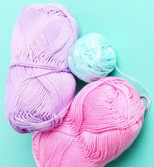 Threads wool rolls on pink
