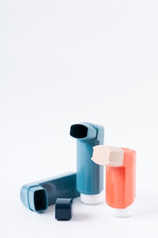 Three asthma inhalers on an isolated on white . selective focus.