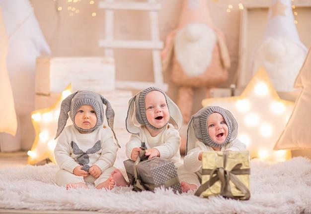 Three baby boys in christmas costume