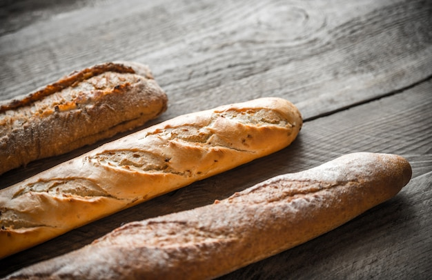 Three baguettes on the wooden table