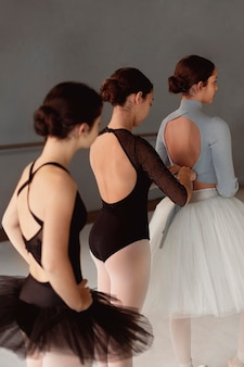 Three ballerinas rehearsing in tutu skirts