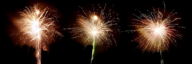 Three bang fireworks on a black sky