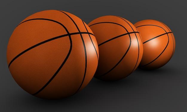 Три баскетбольных мяча на сером фоне
