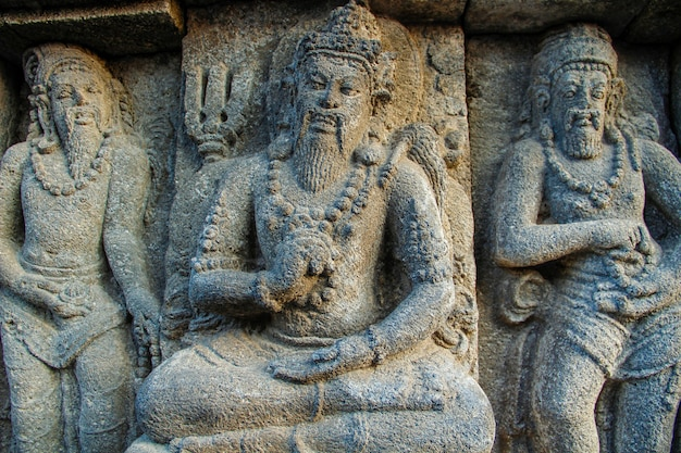 Three beautiful figures in the prambanan temple. indonesia