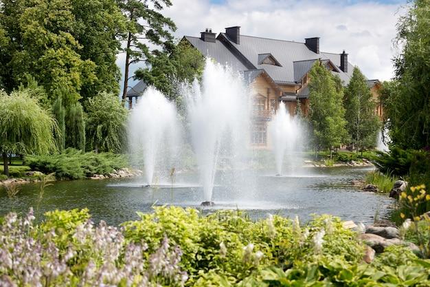 Three beautiful fountains on lake at botanical garden