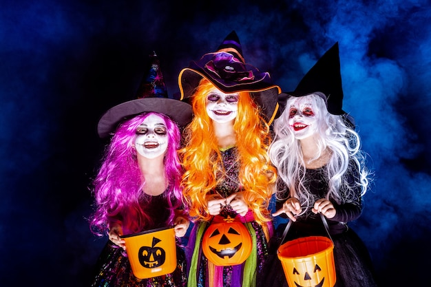 Three beautiful girl in a witch costume