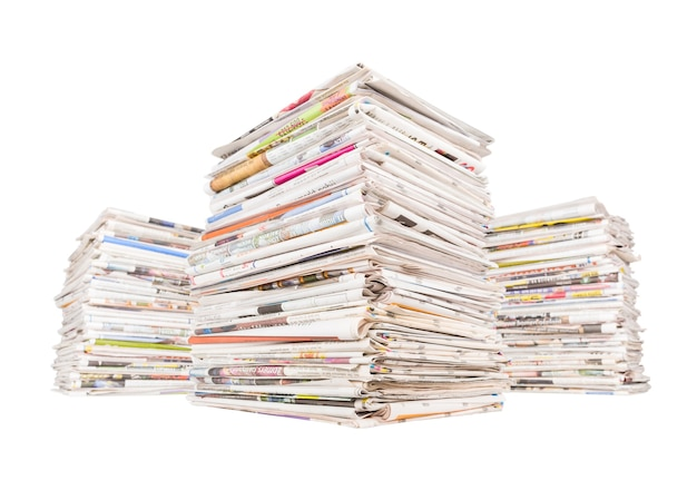 Three big stacks of newspapers isolated on white background