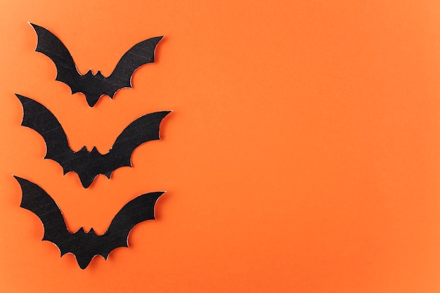 Three black paper bats for halloween