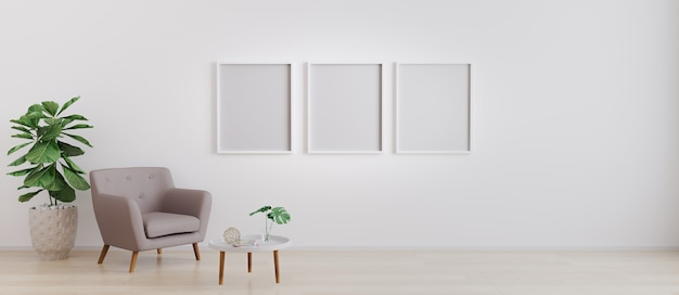 Three blank photo frames on wall. insert your photo. modern interior of living room
