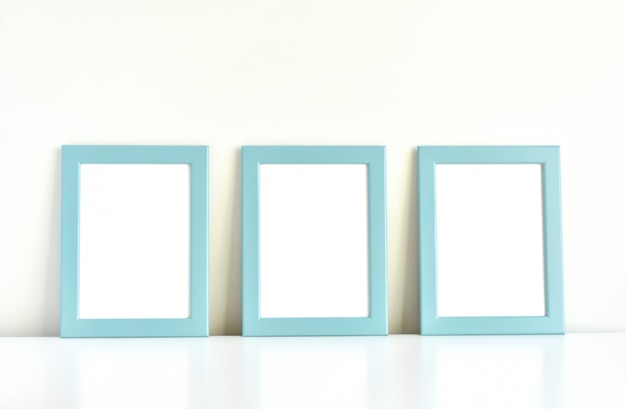 Three blue frames on white table.
