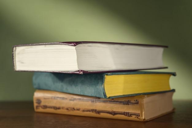 Three books on a green