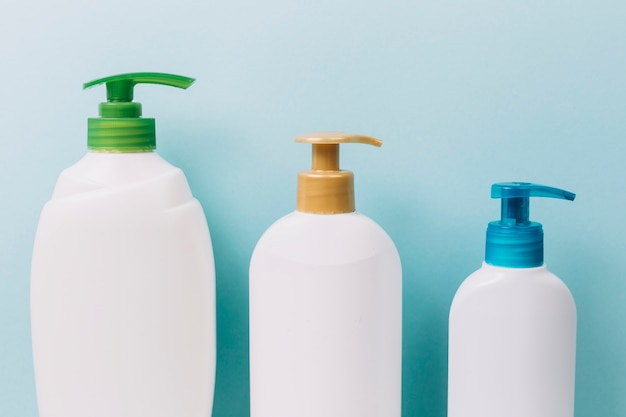 Three bottles with bright pumps