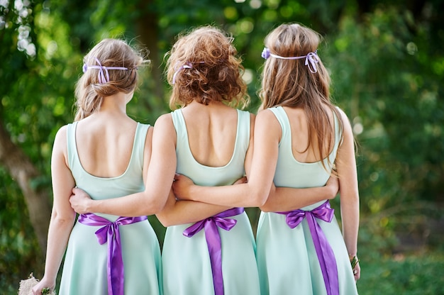 Three bridesmaids are back in the park