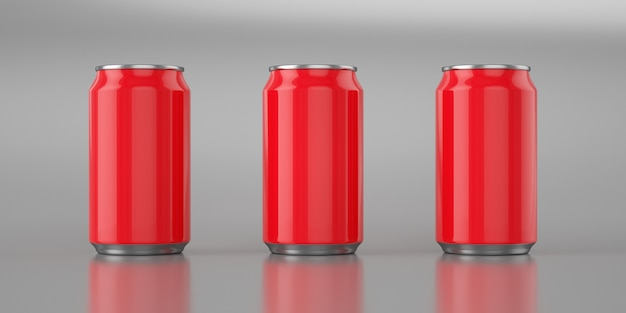Three bright red cola cans on metal background