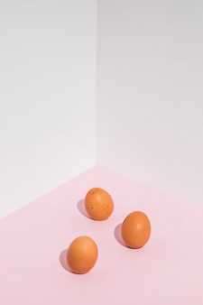 Three brown chicken eggs on table