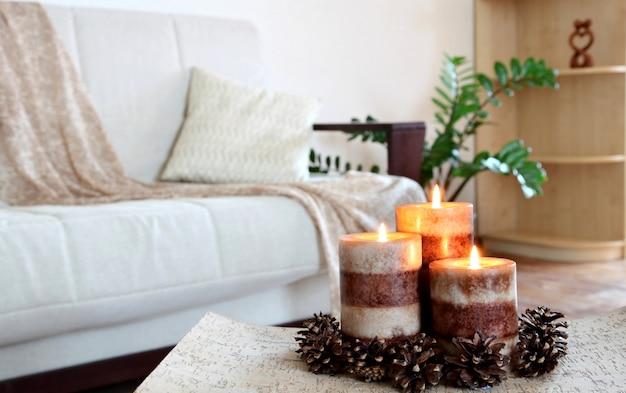 Three burning candles. home decor. living room decoration.