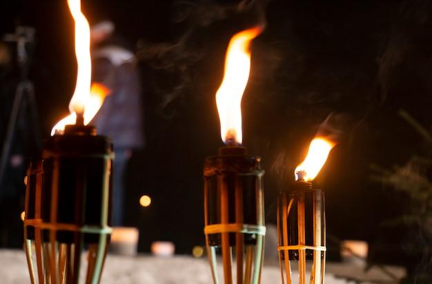Three burning torches at night zemoy