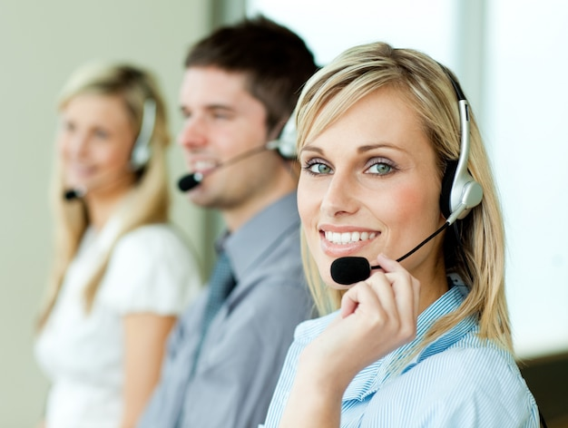 Three businesspeople working with headsets