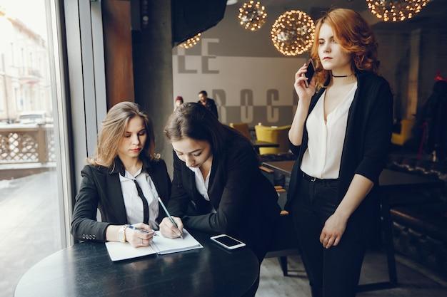 Three businesswomen in a cafe