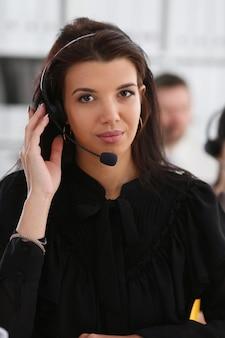 Three call centre service operators at work