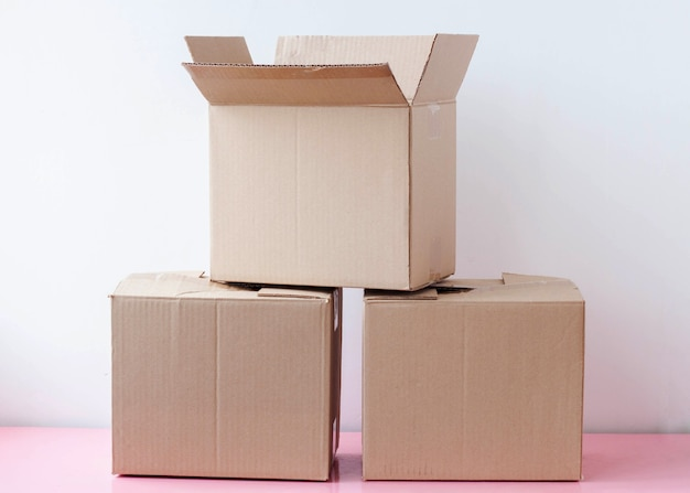 Three cardboard boxes stacked on white background