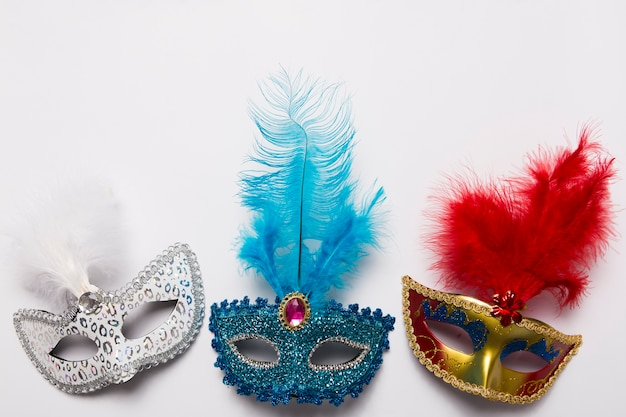 Three carnival masks on white